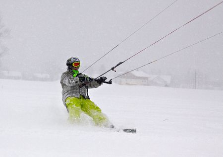 snowkiting: Young men in action snowkiting