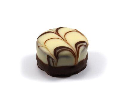 Chocolate praline on white background - Schokoladenpraline vor weissem Hintergrund.