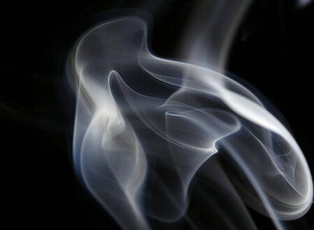 Swirls of smoke on a black background. Stock Photo