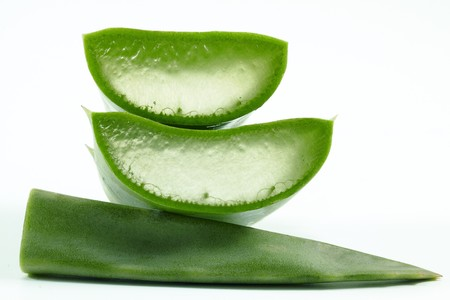 aloe vera background: Slices of aloe vera plant on white background. Stock Photo