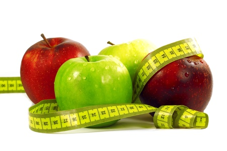 diet concept with apple and a measure tape