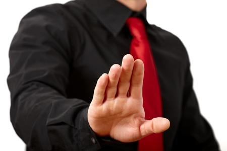 gestos: Hombre de negocios diciendo parada. En un fondo blanco.