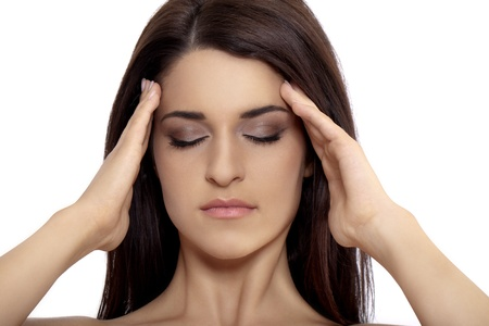 woman having headache and rubbing forehead.photo taken on: august 22th, 2011 스톡 사진
