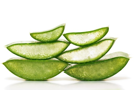 Green juicy slices of aloe vera isolated on white.Photo taken on: September 27th, 2011 photo