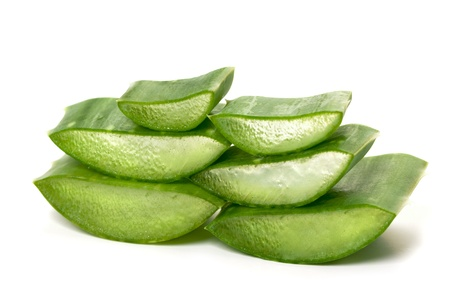 Green juicy slices of aloe vera isolated on white.Photo taken on: September 27th, 2011