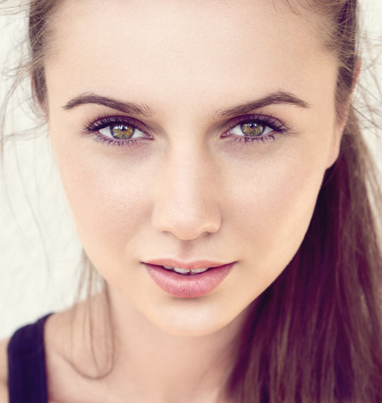 Pretty young female face posing. Stock Photo