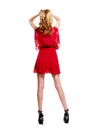 Woman in red dress and heels.