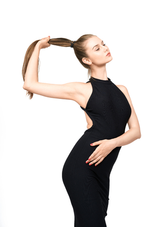 Young woman posing in black dress.