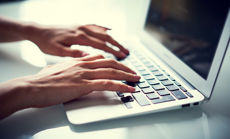 Young woman working on laptop. Stock Photo