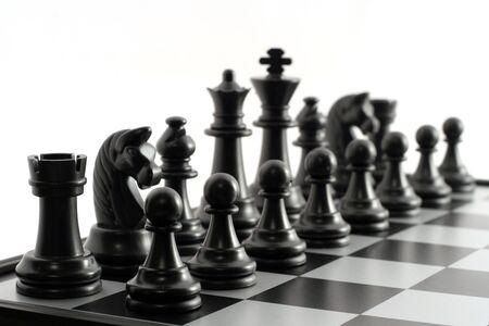 Black chessmen on a chessboard Stock Photo - 3041847