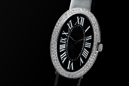 closeup of the luxurious ladys watch a black background photo