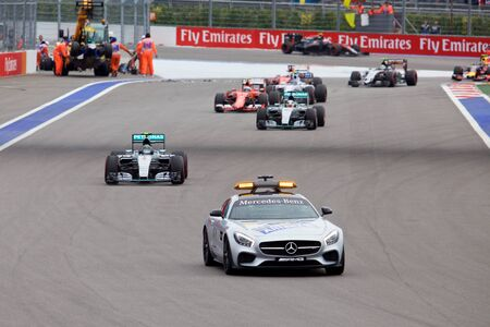formule: Sochi, Russia - October 11, 2015: Nico Rosberg of Mercedes AMG Petronas F1 team leads behind the FIA Safety Car at the race of Formula One Russian Grand Prix at Sochi Autodrom. Editorial
