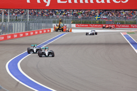 formule: Sochi, Russia - October 11, 2015: Lewis Hamilton of Mercedes AMG Petronas F1 Team leads Nico Rosberg Mercedes AMG Petronas Formula 1 Team at the race of Formula One Russian Grand Prix at Sochi Autodrom. Editorial