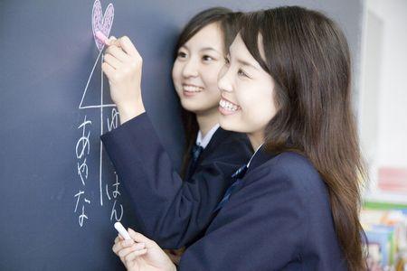scribbling: High school girl scribbling on a blackboard