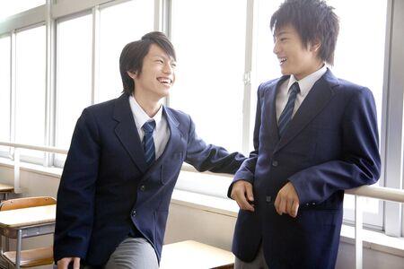 schoolroom: High school boy talking with friend Stock Photo