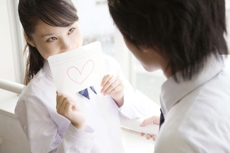 declaring: High school girl declaring her love for classmate Stock Photo