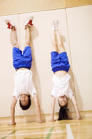 bellybutton: High school syudents doing handstand
