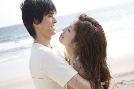 Couple hugging each other on a beach