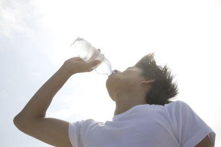 man drinking water: Japanese man drinking a water