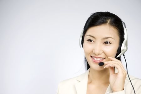 talks: Business lady who talks with headset Stock Photo