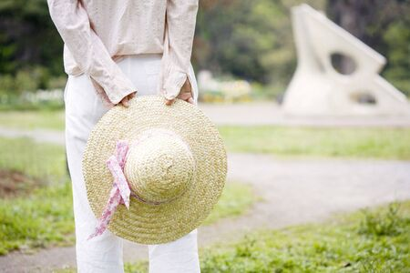straw hat: Straw hat and woman Stock Photo