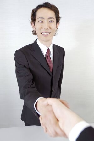 shakes hands: Office worker who shakes hands Stock Photo