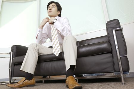 sits on a chair: Office worker who sits on the chair