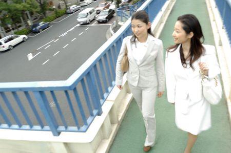 overpass: Woman who crosses a pedestrian overpass