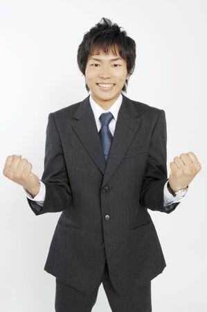 clenching fists: Business lady clenching fists in triumph