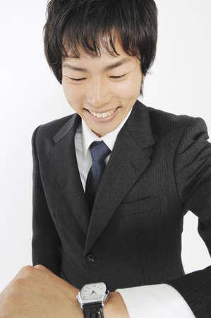 wristwatch: Businessman to see a wristwatch Stock Photo