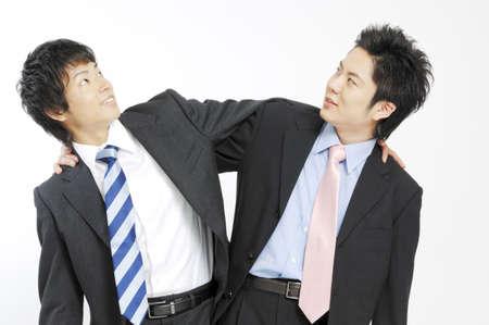 grappling: Businessmen grappling each shoulder