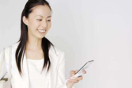 lady on phone: Business lady checking email of cell phone Stock Photo