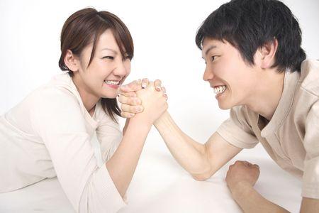 wrestle: Couple doing arms wrestle Stock Photo