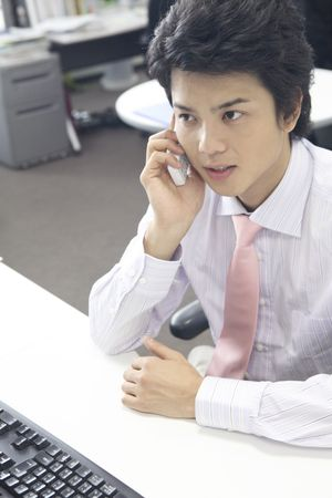 potable: Businessman speaking with a cell phone Stock Photo