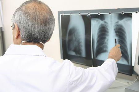 explaining: Physician explaining an X-ray