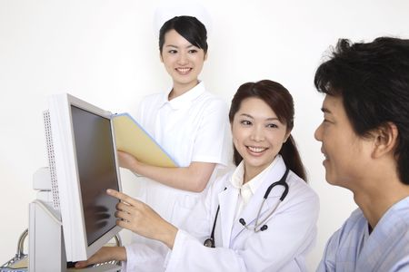 explanations: Doctor explaining by a monitor Stock Photo