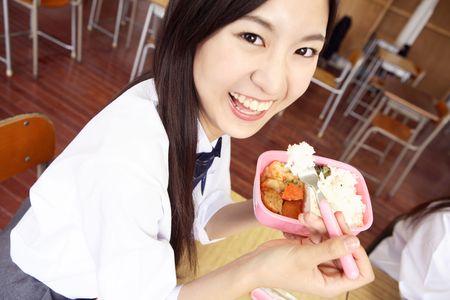 schoolroom: High school girl eating box lunch