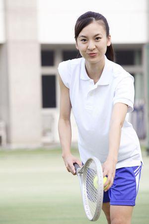 schoolroom: High school girl playing tennis