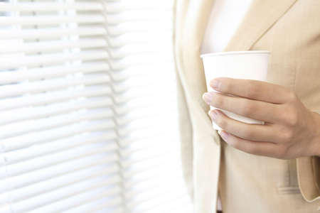paper cup: Office lady having a paper cup Stock Photo