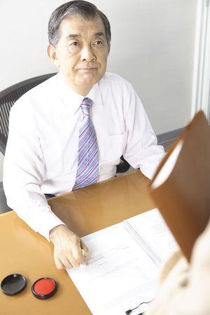 chief executive officer: Chief executive officer pushing the stamp