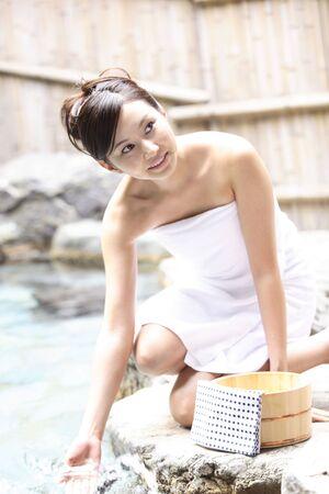 woman in bath: Japanese woman at the open-air bath Stock Photo