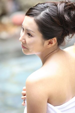 woman in bath: Japanese woman in the open-air bath Stock Photo
