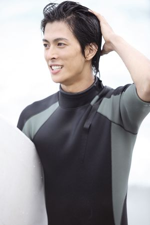 wet suit: Young Japanese surfer