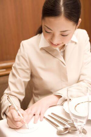 memo: Japanese woman taking memo Stock Photo