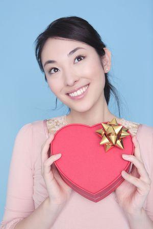 heart shaped box: Woman having heart shaped box