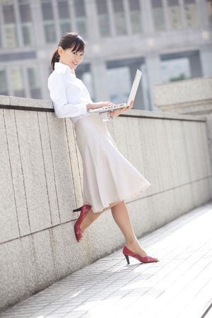 wor: Japanese office lady operating a PC Stock Photo