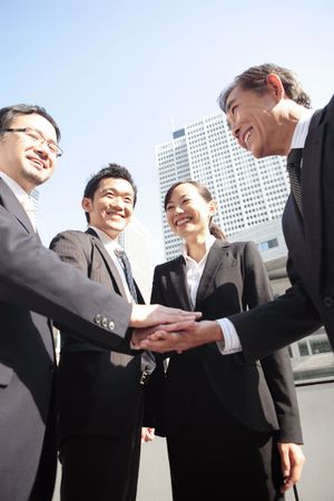 strengthen: Japanese office workers strengthen solidarity Stock Photo