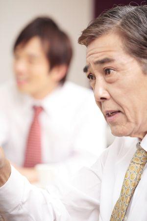 eagerly: Japanese executive talking eagerly
