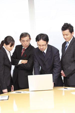 Japanese office workers having a brief meeting 版權商用圖片