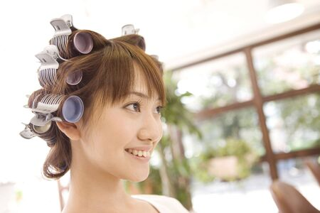 beauty parlor: Japanese girl in the beauty parlor for a perm Stock Photo